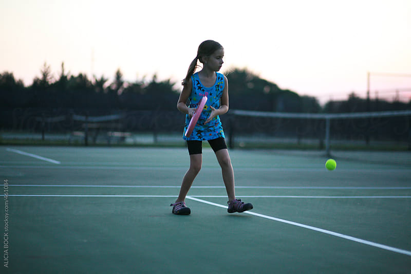 Girl Playing Tennis At Sunset by ALICIA BOCK for Stocksy United