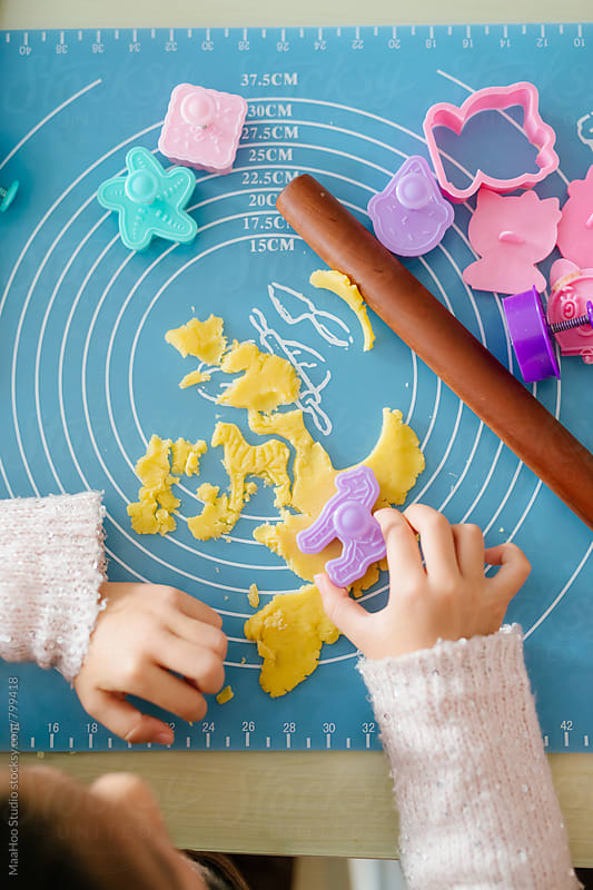 Little girl baking biscuits by MaaHoo Studio for Stocksy United