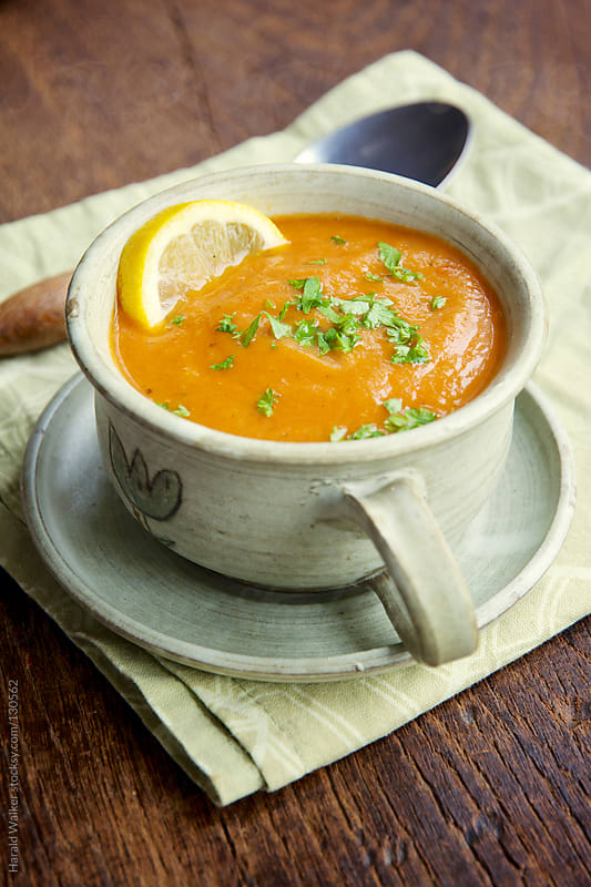 Spicy Parsnip and Tomato Soup by Harald Walker for Stocksy United