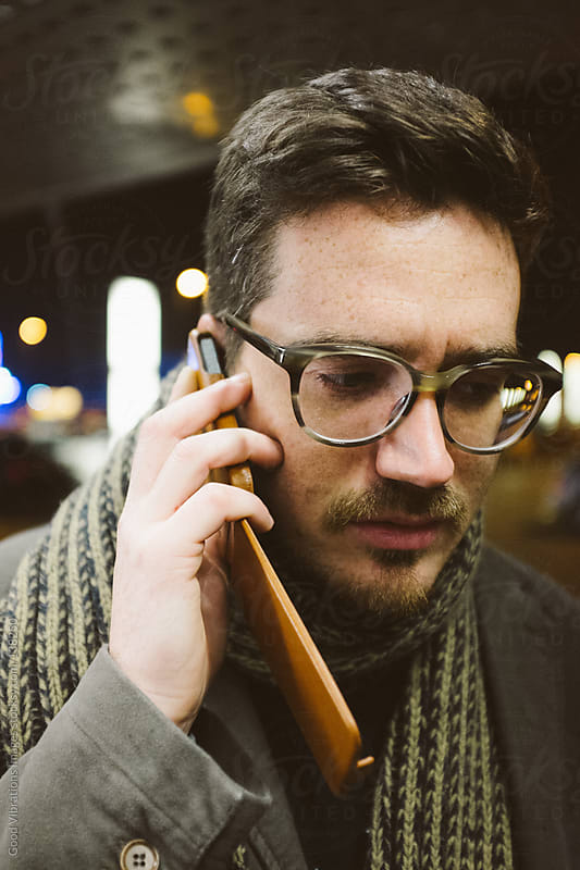 Man at the phone by Good Vibrations Images for Stocksy United