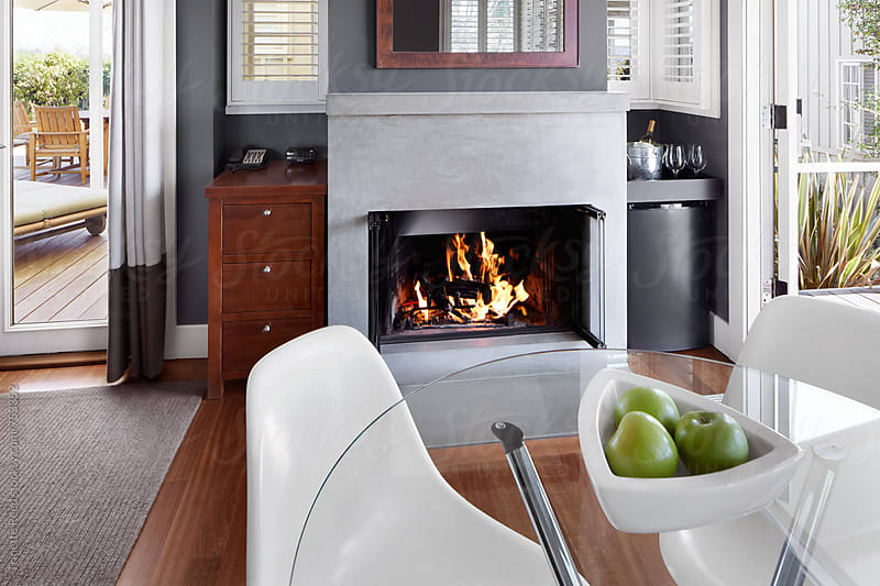 Fireplace in living room of small cottage by Trinette Reed for Stocksy United