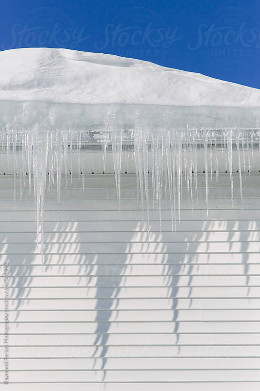 Icicle on Roof by Raymond Forbes LLC for Stocksy United