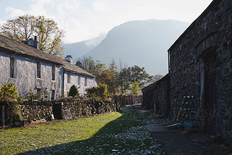 Rural farm in a mountain valley. Cumbria, UK. by Liam Grant for Stocksy United