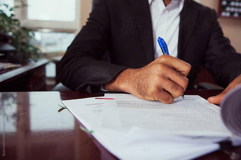Lawyer: Working On Legal Documents by Sean Locke for Stocksy United