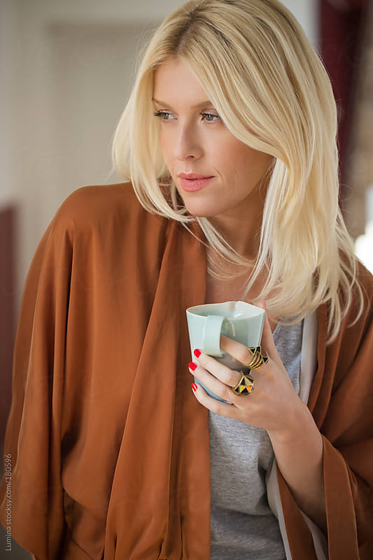 Blonde Woman Drinking Tea by Lumina for Stocksy United