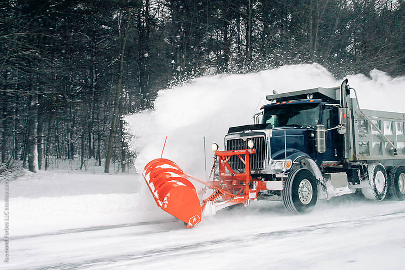 Truck Plowing Snow on Highway New Hampshire by Raymond Forbes LLC for Stocksy United