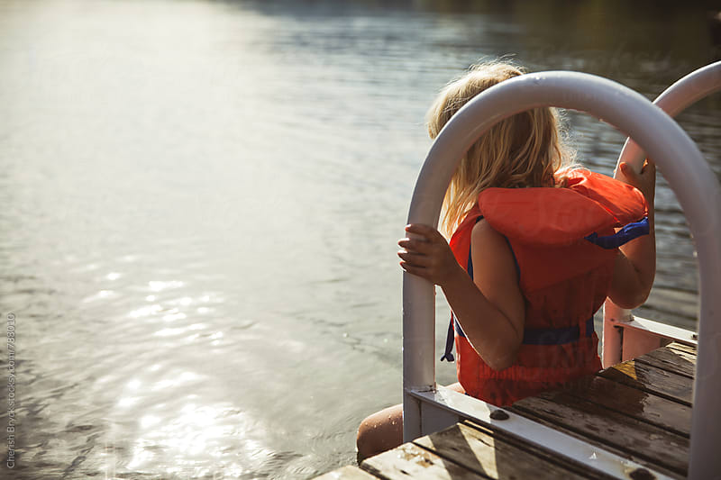 Getting ready to get in the lake. by Cherish Bryck for Stocksy United