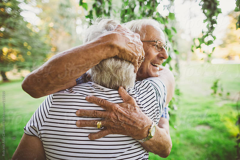 Cute elderly couple hugging together by Rob and Julia Campbell for Stocksy United