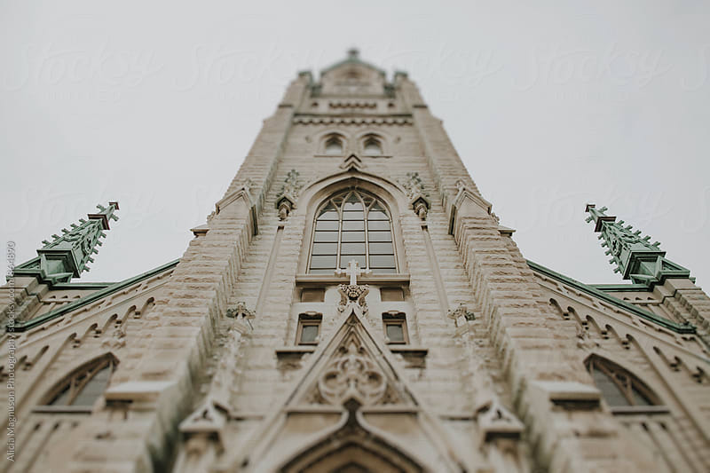 Looking up at Old Catholic Church Entrance by Alicia Magnuson Photography for Stocksy United