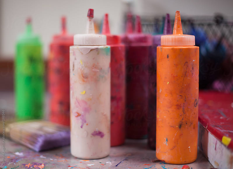 Bottles of paint in an artist's studio by Carolyn Lagattuta for Stocksy United