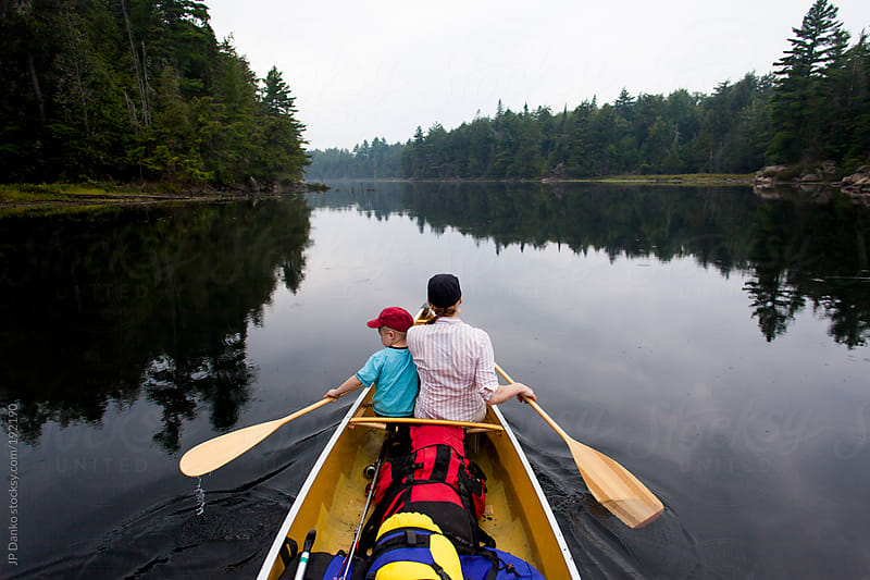 Mom and Boy On Quiet Wilderness Camping Trip In Canoe on Lake by JP Danko for Stocksy United
