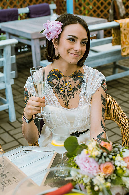 Portrait of a bride with a glass of champagne by Yury Goryanoy for Stocksy United