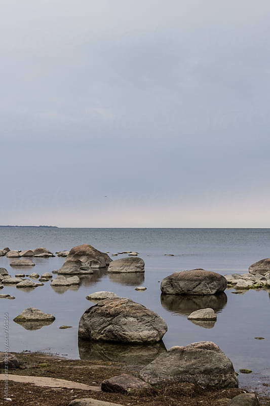 Rocks at the shore of the sea, Kaesmu Bay, Estonia by Melanie Kintz for Stocksy United