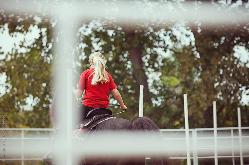 Equestrian: Rear View of Girl Riding Horse by Sean Locke for Stocksy United
