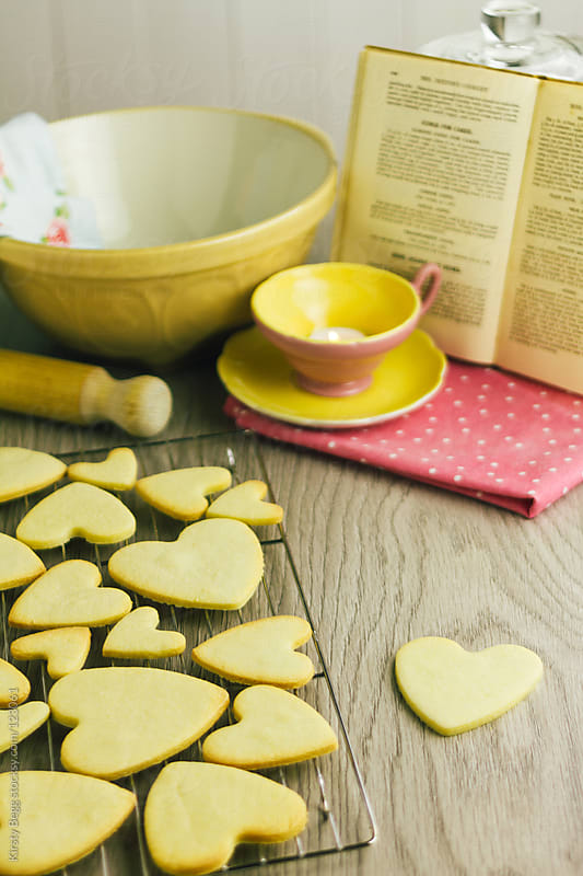 Heart shaped cookies with cookbook by Kirsty Begg for Stocksy United