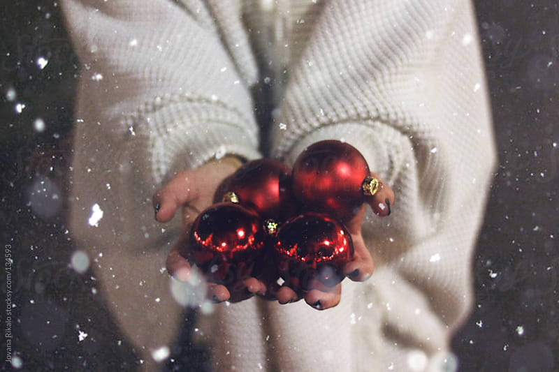 Girl holding Christmas decorations in her hands by Jovana Rikalo for Stocksy United