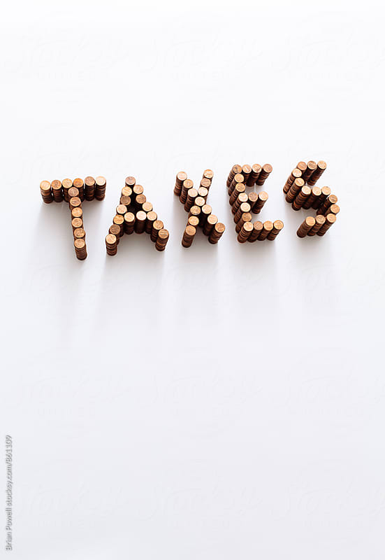the word TAXES in pennies by Brian Powell for Stocksy United