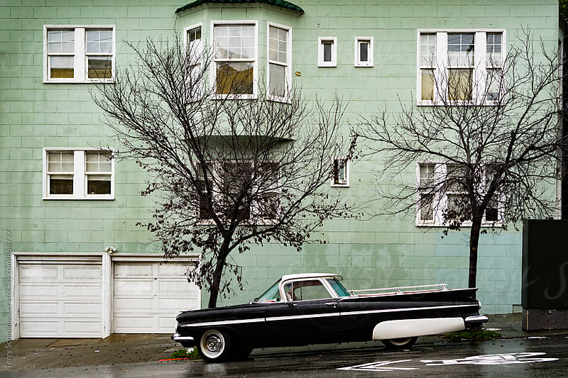 Retro Car on Rainy Street by Terry Schmidbauer for Stocksy United