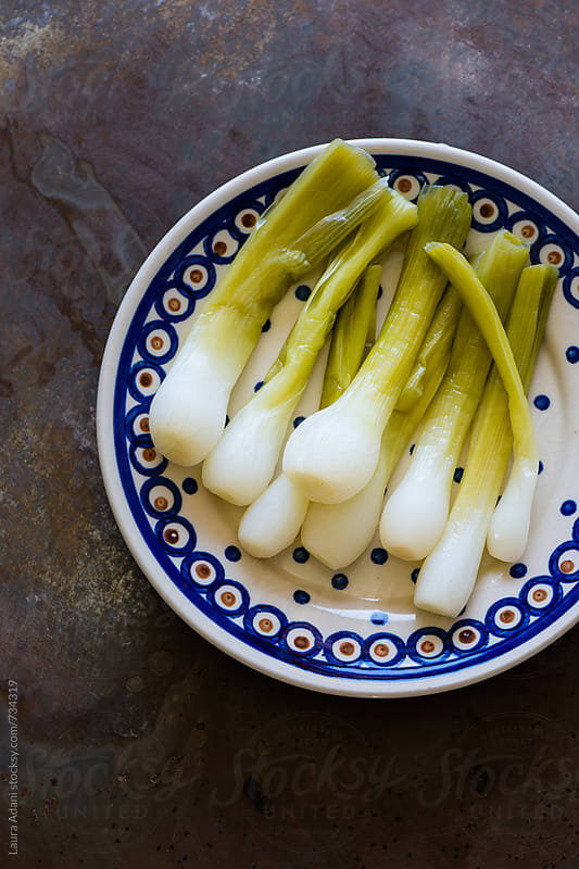 steamed green onions by Laura Adani for Stocksy United