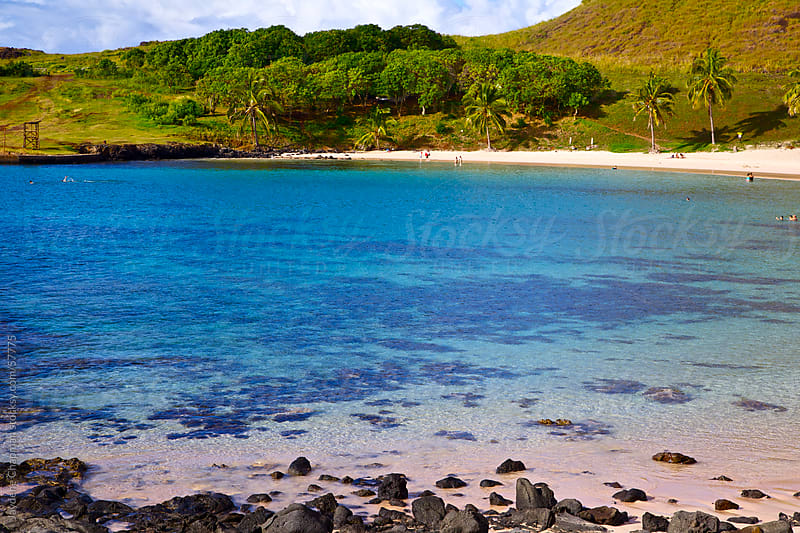 The beautiful clear blue waters of a swimming bay, Anakena beach, Easter Island, Chile by Jaydene Chapman for Stocksy United