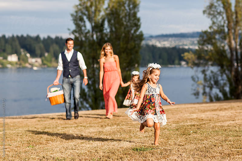 Family playing in a park by Suprijono Suharjoto for Stocksy United