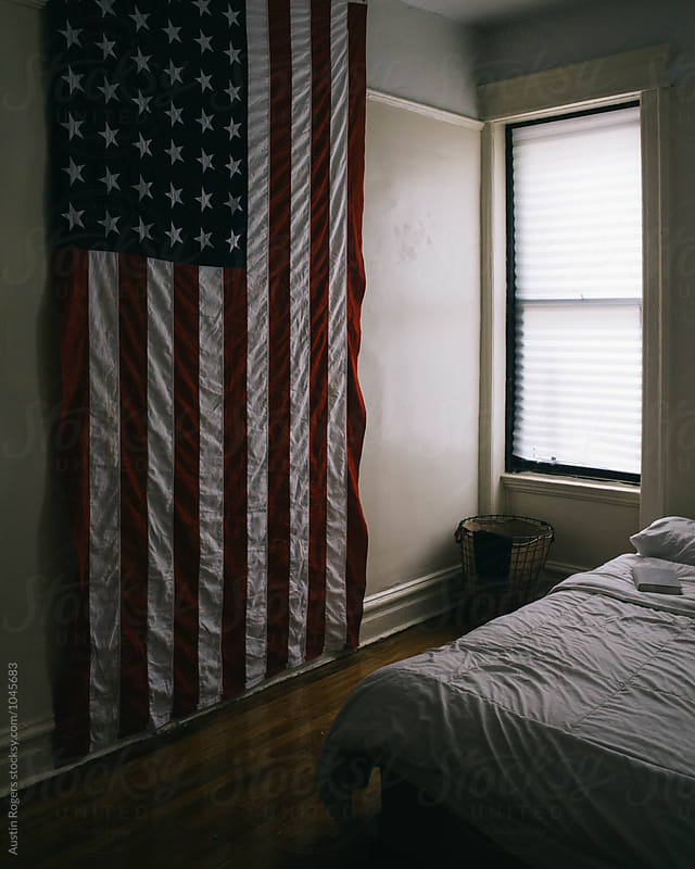 Apartment window with large American flag