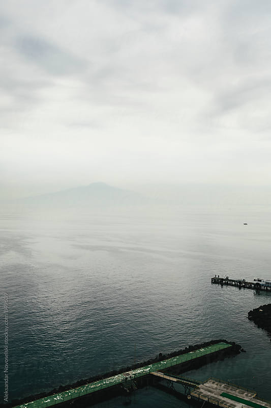 Minimalist seascape on a cloudy day with a boat in Sorrento, Italy by Aleksandar Novoselski for Stocksy United