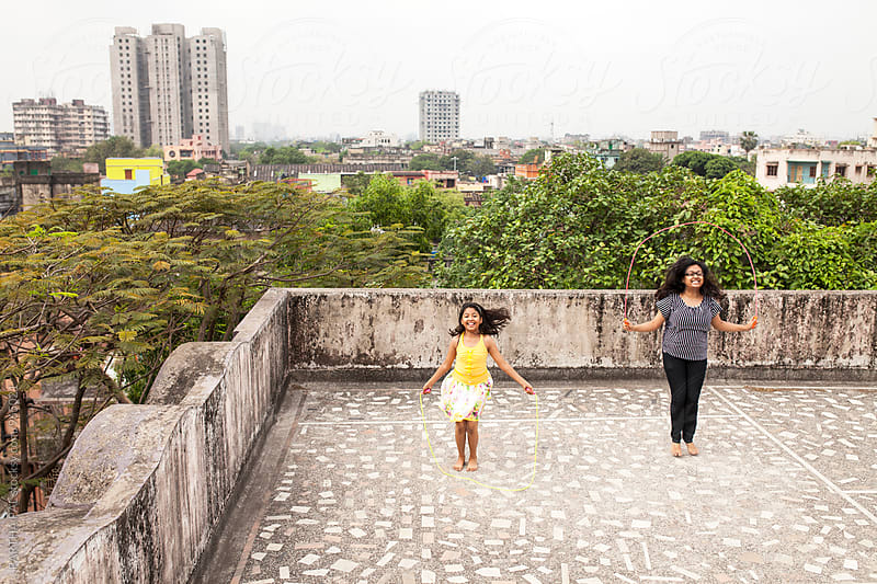 Two sisters exercising at the rooftop of old city of Kolkata by PARTHA PAL for Stocksy United