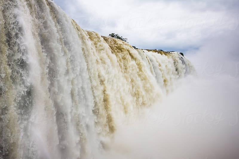 Waterfall in Iguassu falls. Water flowing by Alejandro Moreno de Carlos for Stocksy United