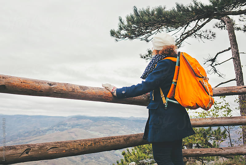 Woman With a Backpack Looking at a Beautiful Mountain Landscape by Lumina for Stocksy United
