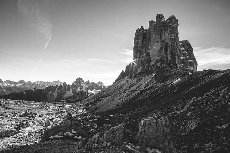 sunset at the famous three pinnacles in black and white by Leander Nardin for Stocksy United
