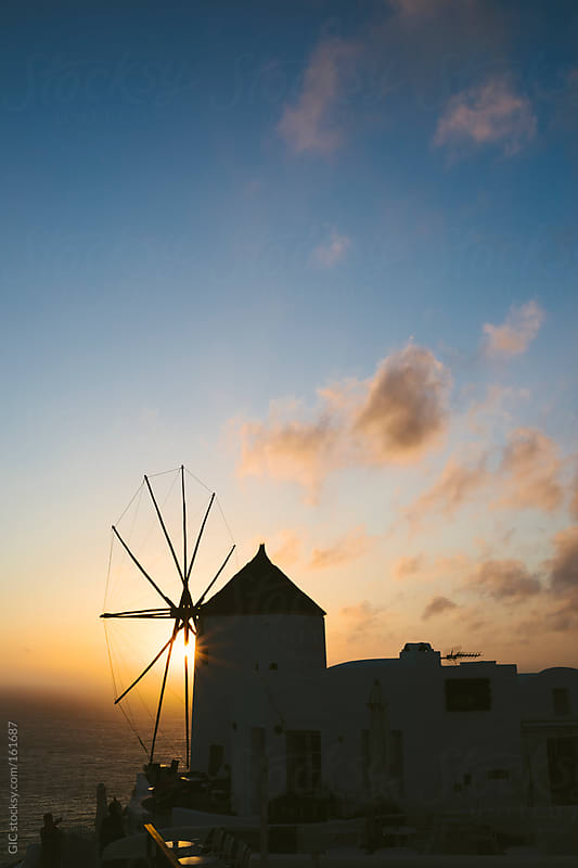 Silhoutte of a windmill in Santorini by GIC for Stocksy United