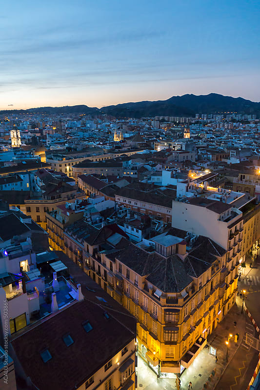 Aerial view of Malaga city at blue hour by ACALU Studio for Stocksy United