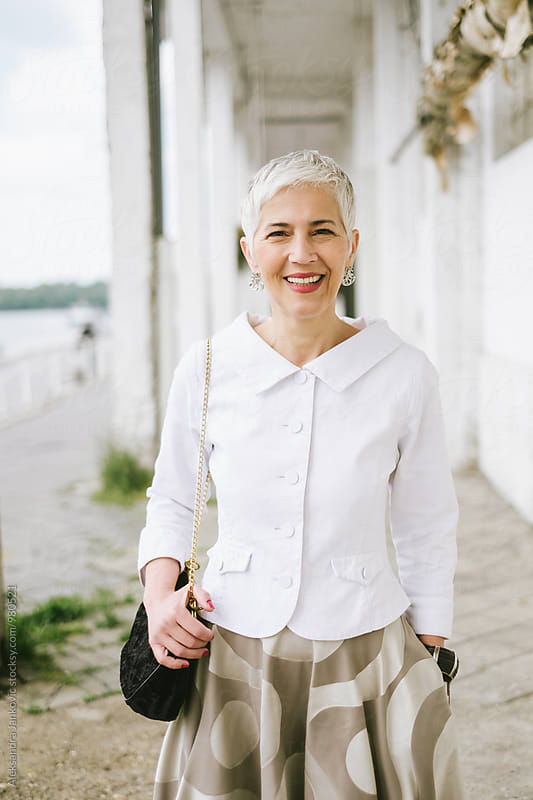 Portrait of a Smiling Senior Woman by Aleksandra Jankovic for Stocksy United
