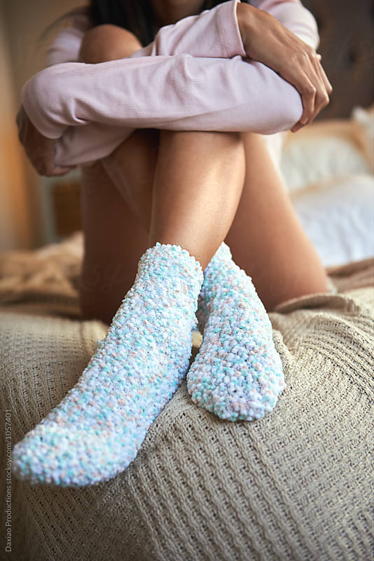 cute socks woman legs on bed by Daxiao Productions for Stocksy United