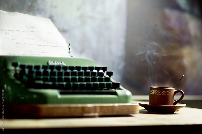 Vintage typewriter and coffee on wooden desk by Marija Anicic for Stocksy United
