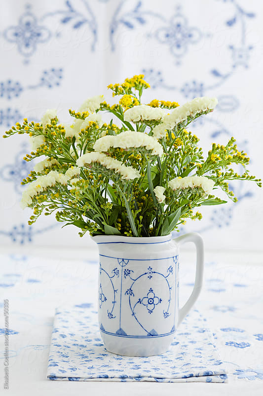 Solidago flower bouquet by Elisabeth Coelfen for Stocksy United