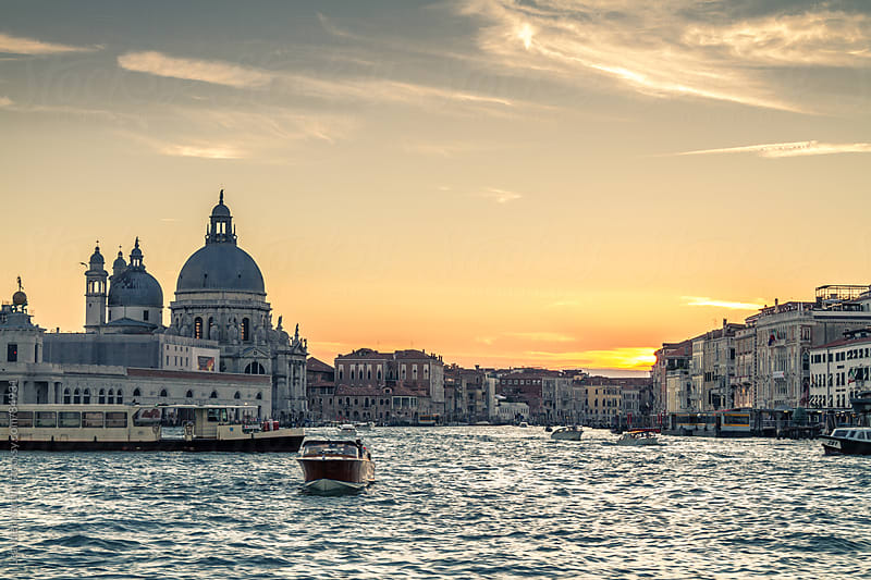 Santa Maria della Salute and the Grand Canal at sunset by Leander Nardin for Stocksy United