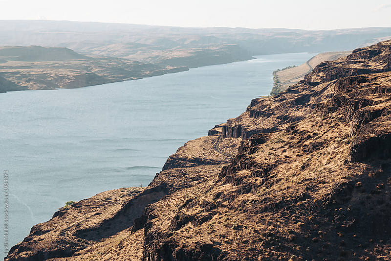 Columbia River far below rocky cliffs.  by Justin Mullet for Stocksy United