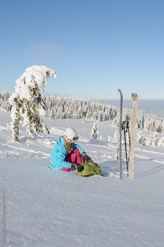 Female skier taking a ski break by RG&B Images for Stocksy United