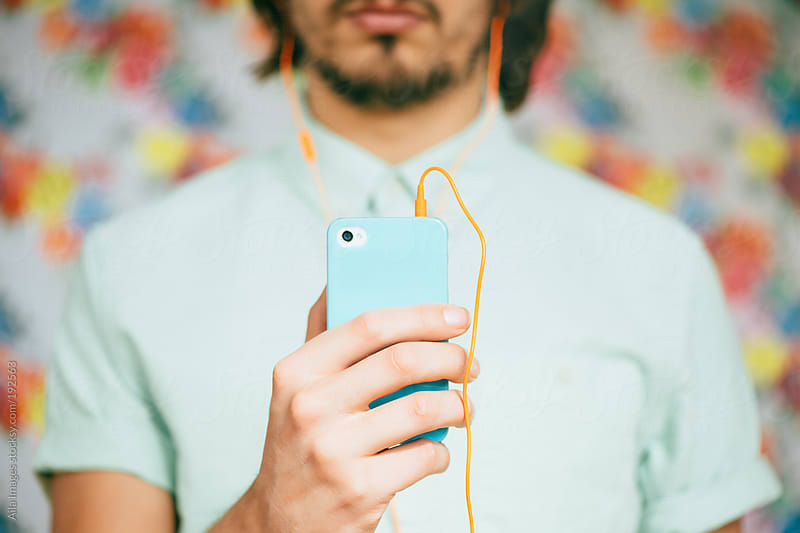 Trendy hipster using smart phone by Aila Images for Stocksy United