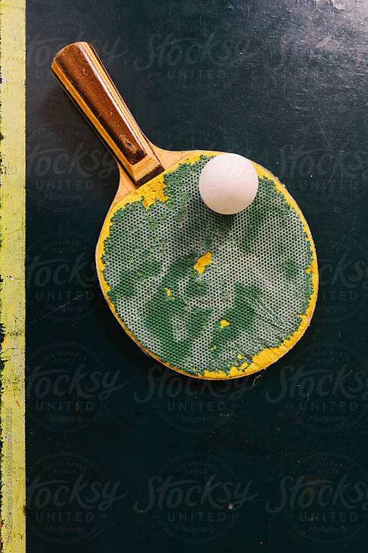 Green table tennis racket and ball by Urs Siedentop & Co for Stocksy United