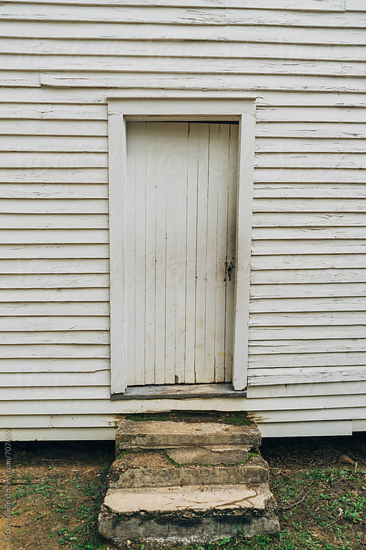 White vintage door by Adam Nixon for Stocksy United