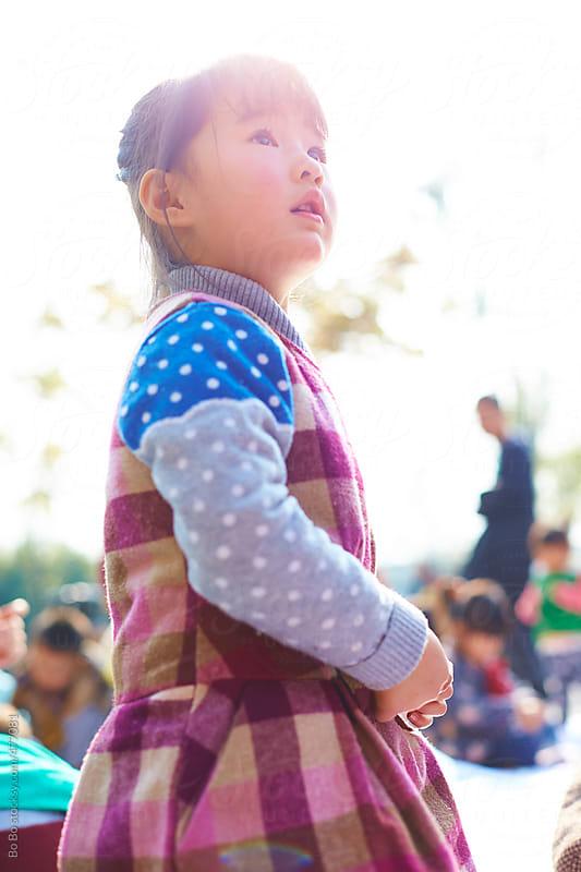 little asian girl in the park by Bo Bo for Stocksy United