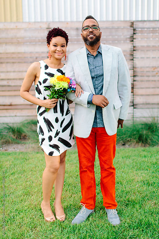 Stylish couple celebrating their engagement at the park by Kristen Curette Hines for Stocksy United