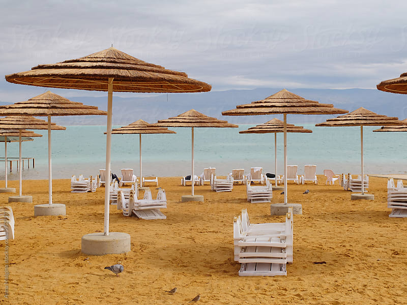 An empty beach on Dead Sea by Anna Malgina for Stocksy United