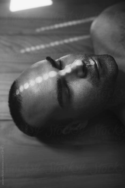Shadow on man's face by Jovana Rikalo for Stocksy United
