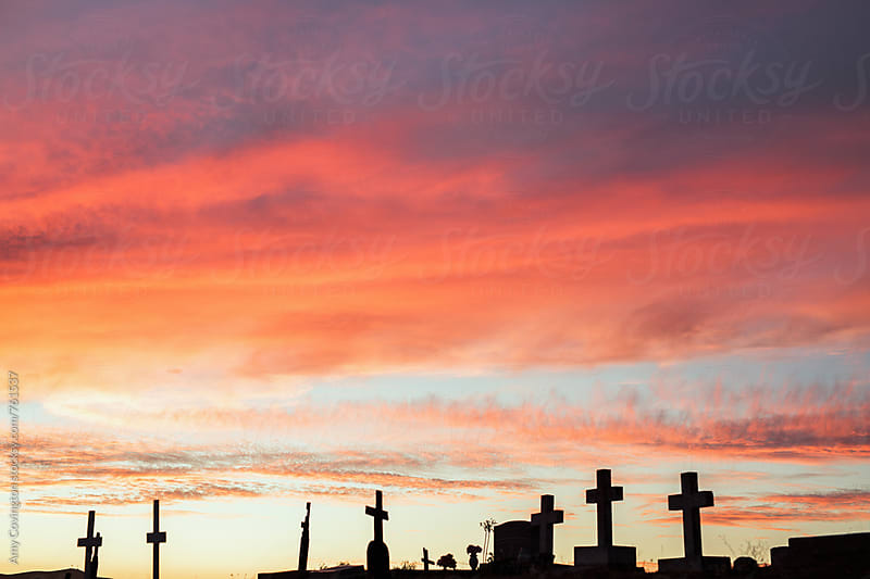 Beautiful sunset view from a hilltop cemetery  by Amy Covington for Stocksy United