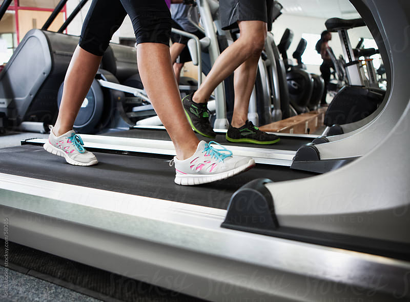 Gym: Anonymous Walkers on Treadmill by Sean Locke for Stocksy United