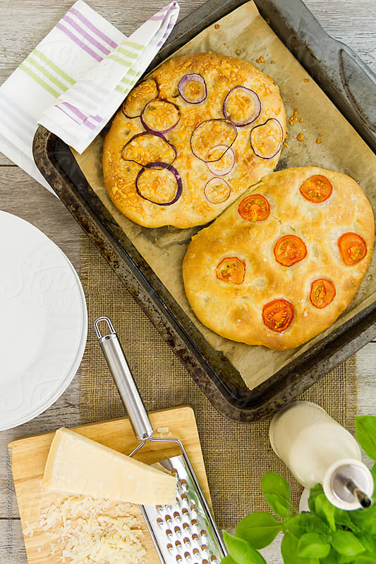 Freshly baked focaccia from above by Kirsty Begg for Stocksy United